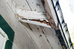 Rotting eves of house. Looking up at rotting damaged eves under a roof on a house Royalty Free Stock Photography