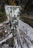 Rotting fence rocky cliff Stock Photo