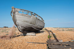 Rotting  Fishing Boat and Nets. Rotting wooden fishing boat and nets on a beach Royalty Free Stock Photos