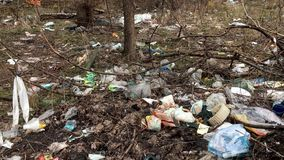 Rotting garbage after winter in the city park. Pollution of the environment. stock footage