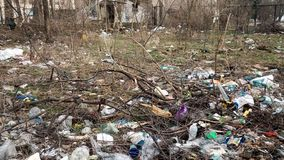Rotting garbage after winter in the city park. Pollution of the environment. stock video footage