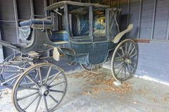 Rotting Horse Carriage in Rustic Rural Farm Barn royalty free stock image