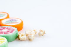 Rotting milk teeth with sweets. Rotting baby milk teeth with candy coloured sweets Stock Image