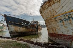Rotting ships with peeling paint and rotten structures on the Cemetery boat stock photography