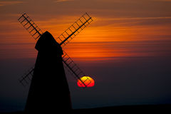 Rottingdean Windmill. In silhouetted against a vibrant setting sun Stock Photos