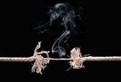 Rottura della corda Immagine Stock