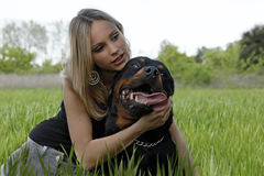 Rottweiler and teenager Royalty Free Stock Images