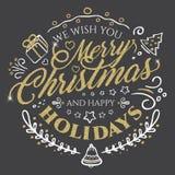 Rotulação caligráfica para o Feliz Natal e ano novo feliz com efeito dourado do brilho no fundo escuro Imagens de Stock Royalty Free