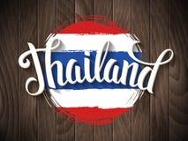 Rotulação de Tailândia no fundo da bandeira nacional Imagem de Stock Royalty Free