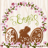 Rotulação feliz da Páscoa, pão-de-espécie sob a forma dos ovos Feriados da mola, fundo da Páscoa Fotografia de Stock Royalty Free
