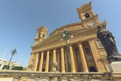 Rotunda Mosta Malta. Domed 17th-century Catholic Church with neoclassical architecture and replica WWII bomb on display, Dutch angle Royalty Free Stock Images