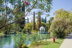 Rotunda on the shore of a lake in the Seaside Park on a sunny summer day. NEW ATHOS, ABKHAZIA, GEORGIA, 19 SEPTEMBER 2017: Rotunda on the shore of a lake in the Stock Photography