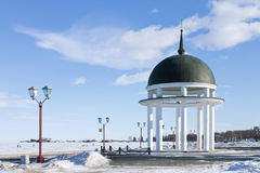 Rotunda on winter embankment on the Onego lake in Petrozavodsk, Russia Royalty Free Stock Photo