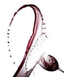 Rotwein-abstraktes Spritzen lokalisiert auf Weiß Stockfotografie