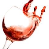 Rotwein, der unten gießt Lizenzfreies Stockbild