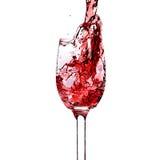 Rotwein des Spritzens in einem Glas. Lizenzfreie Stockfotos