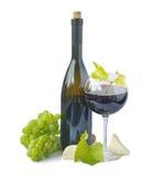 Rotwein und Trauben Stockfotografie