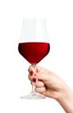 Rotweinglas in der Hand Lizenzfreies Stockbild