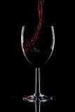 Rotweinspritzen Stockfoto