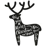 Rotwild silhouettieren mit dem Beschriften von frohen Weihnachten Stockbild
