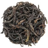 Rou Gui Wuyi Shan roasted oolong round shape isolated. Above view stock image