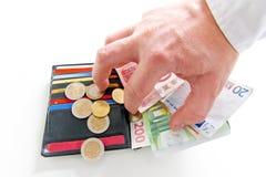 Roubando o dinheiro Fotografia de Stock Royalty Free
