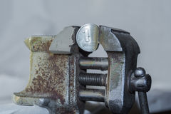 Rouble in old vise. One russian rouble under pressure in old rusty vise. Russian economic crisis concept Royalty Free Stock Photos