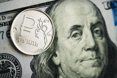 Roubles coins on banknotes of dollars Royalty Free Stock Photography