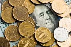 Roubles coins on banknotes of dollars Stock Photo