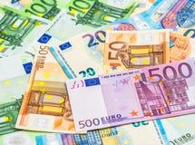5000 roubles för modell för bakgrundsbillspengar Olika eurosedlar för Closeup Arkivfoto
