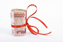 Roubles with red bow Royalty Free Stock Images