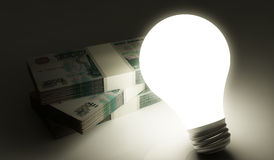 Roubles stack with lightbulb Royalty Free Stock Image