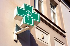 The typical green sign for pharmacies and healtcare related shops. ROUDNICE NAD LABEM, CZECH REPUBLIC - MAY 25, 2019: The typical Czech unified green sign for stock image