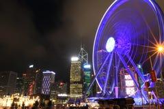 Roue d'observatoire du HK de vue de nuit et parc d'attractions images libres de droits