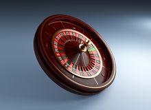 Roue de roulette de luxe de casino sur le fond bleu Illustration en bois de rendu de la roulette 3d de casino Photo libre de droits