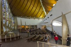 Old stained glass windows in a modern catholic church. royalty free stock photography