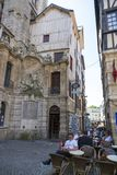 Tourists relax in a cafe on a street in the center of Rouen royalty free stock images