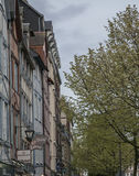 Rouen, Normandy, France - a wall of houses and some trees. The image shows a street in Rouen, France. We can see some of the traditional buildings with the dark royalty free stock image