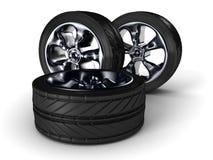 Roues de pneu de voiture sur le fond blanc Photographie stock libre de droits