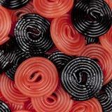 Roues rouges et noires de réglisse photos stock
