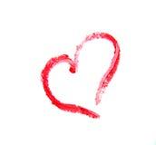 Rouge à lèvres enduit dans la forme de coeur d'isolement sur le fond blanc Photographie stock libre de droits