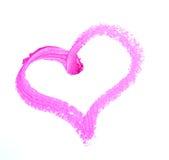 Rouge à lèvres enduit dans la forme de coeur d'isolement sur le fond blanc Photo stock