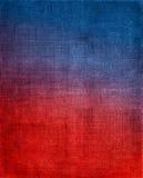 Rouge au fond bleu de tissu Image libre de droits