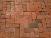 Rouge-brique-trottoir photo stock