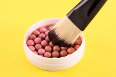 Rouge and brush Stock Photos