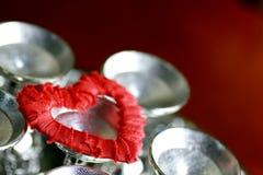 Rouge d'argent de forme de coeur Photo libre de droits