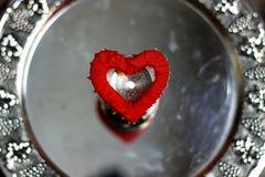 Rouge d'argent de forme de coeur Images libres de droits