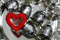 Rouge d'argent de forme de coeur Photos stock