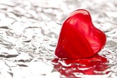 rouge de coeur de clinquant Photographie stock