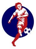Rouge de coup de pied de bille de footballeur Image stock